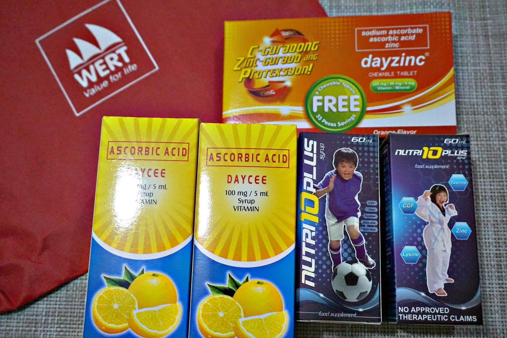 Each pouch contains 2 bottles of Nutri10PlusSyrup 2 bottles of DayCee Vitamin C and Daycee chewables - Mommy Bloggers Shared The Love To Kids In Marawi Through Nutri10Plus Syrup Vitamin Blog Campaign
